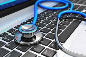 Stethoscope on laptop keyboard representing software installation and repair